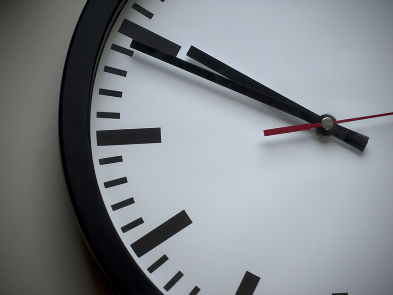 The left side of an analog wall clock.